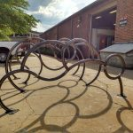 Bike racks being built by UA art alumni.