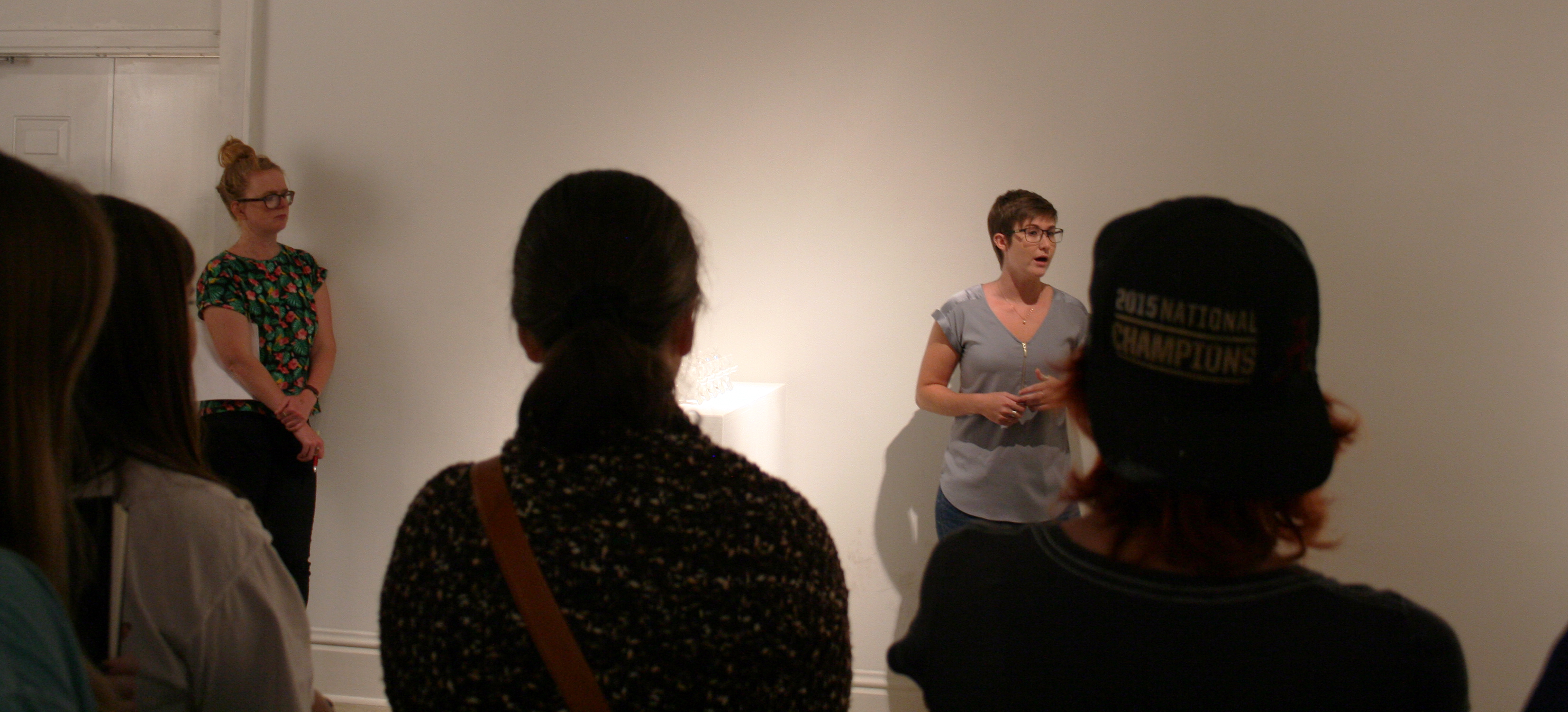 Katie Adams talking about her work in the Graduate Student Show