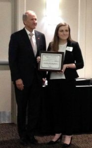 Nadia DelMedico receives the Randall Outstanding Undergraduate Research Award from President Stuart Bell, 4-4-2018