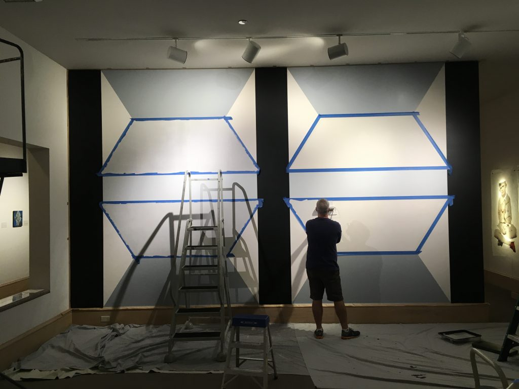 Pete Schulte installing a drawing at the MMFA.