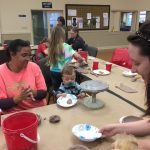Crimson Clay president and grad student in ceramics Amy Smoot teaches an attendee how to make ceramic bowls ahead of the 2018 Empty Bowls project at Grace Presbyterian Church in Tuscaloosa, before the event.