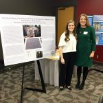 Nadia DelMedico and Dr. Rachel Stephens pose for photos during the Undergraduate Poster Session at UA's 22nd Annual Graduate Student Symposium in Art History.