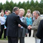 "President Robert E. Witt congratulating Frank Fleming (MFA 1973), April 1, 2011, at the unveiling of his sculpture, ""John the Turtle."""