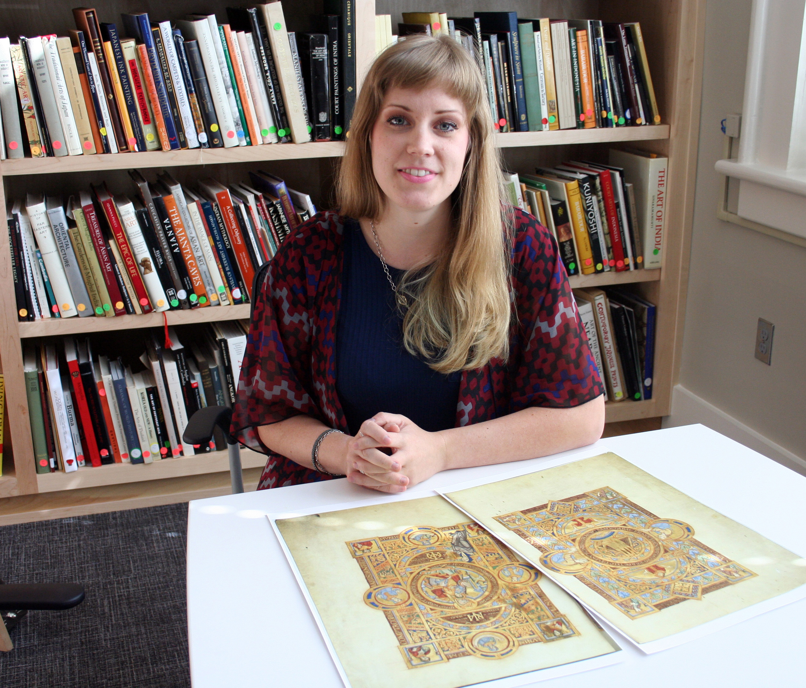 Graduate student in art history Reed O'Mara studies a reproduction of the Uta Codex in the rooms of the Price Collection in Garland Hall.