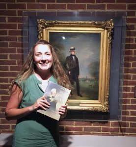 Dr. Rachel Stephens at the Hermitage, standing before a portrait of Andrew Jackson by Ralph Earl, the subject of her new book.
