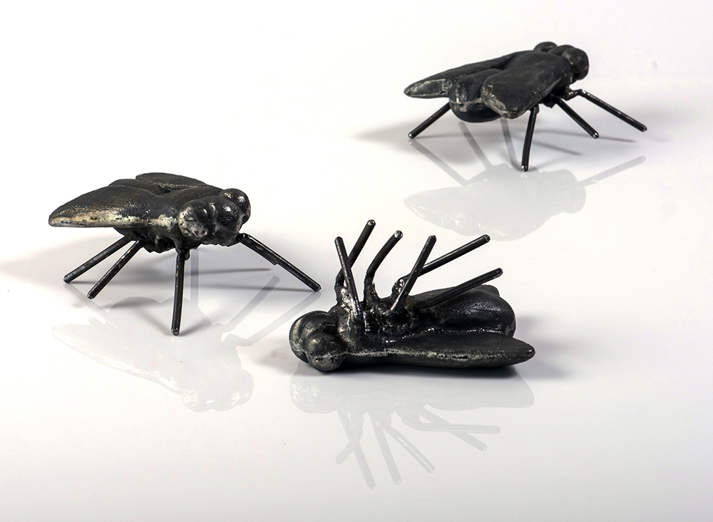 April Livingston, Three Flies, 2016, cast iron and steel, each fly is 3 inches x 4 feet 7 inches