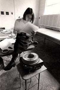 Photo of Professor Gay Burke preparing for class, taken by an unknown student, in the 1970s.