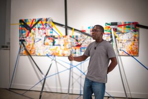Jude Anogwih talks about his work in the Graduate Student Exhibition 2018. Photo by Alyssa Gutierrez, courtesy College of Arts and Sciences.
