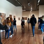 Professor Chris Jordan gives Booker T. Washington Magnet High School photography students a tour of the Sarah Moody Gallery of Art.