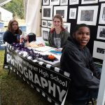 Booker T. Washington Magnet High School photography students welcome visitors at their booth at the 47th Kentuck Festival.