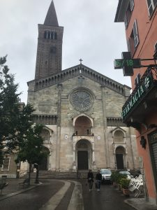 View of Piacenza Cathedral facade (and the pharmacia in front). The work in the south portal (at the right, here) is attributed to Niccolò around 1122. Study Abroad, May 2018. Photo by Rebecca Teague.