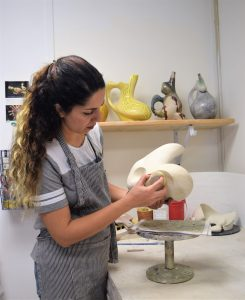 Graduate student Nasrin Iravani working on a ceramics piece for her MA exhibition, 2019. Image courtesy of the artist.