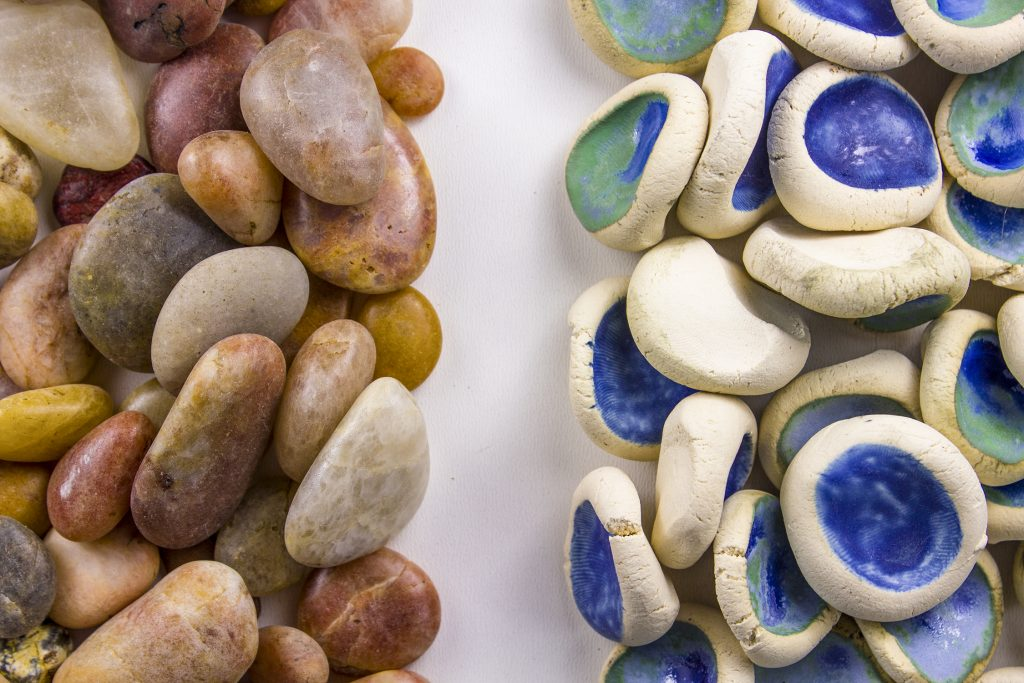 "Patrick Hoban, ""Placeholder"" (detail), ceramic and found rocks, 4' x 9' x 2"". Image courtesy of the artist."