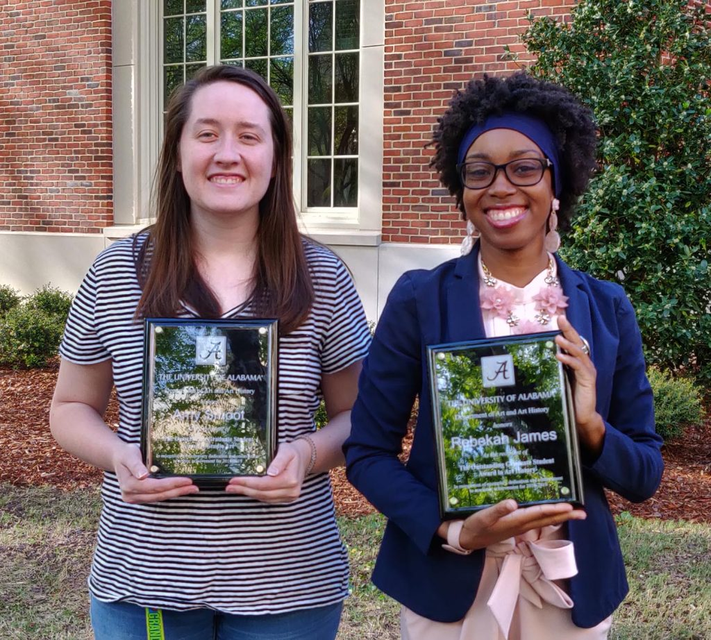 Two students pose with their academic awards.