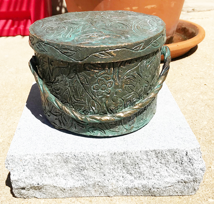 Alysa Boyd's bronze sculpture of a hat box honors author Mark Childress in Monroeville's Literary Capital Sculpture Trail.