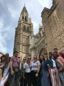 Art and Art History students and faculty stand before the Cathedral of Saint Mary in Toledo.