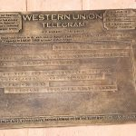Jennifer Gault's bronze sculpture of a telegram announcing Pulitzer Prize awards honors winners Harper Lee, Cynthia Tucker and Hank Williams Sr., in Monroeville's Literary Capital Sculpture Trail.