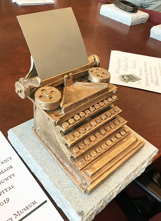 bronze sculpture of a typewriter