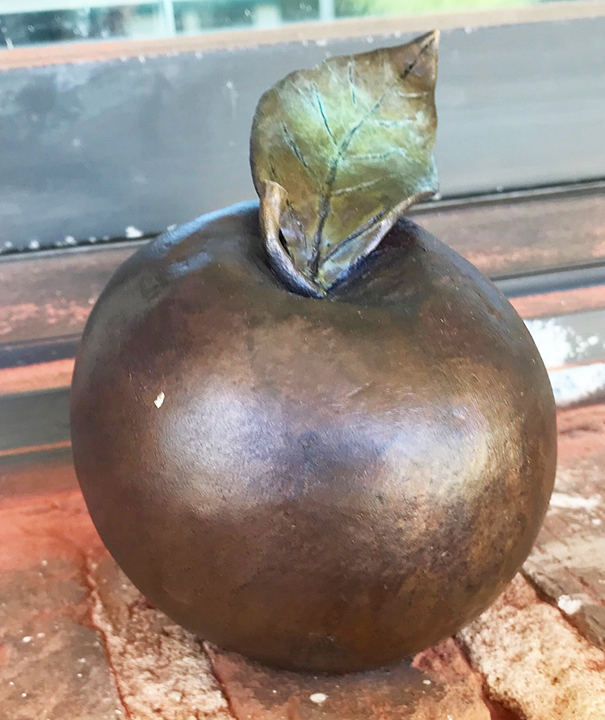 Josh Dugat's bronze sculpture of an apple honors author and educator Marva Collins in the Monroeville Literary Capital Sculpture Trail.