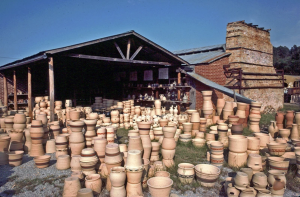 large assortment of pottery outside a shed