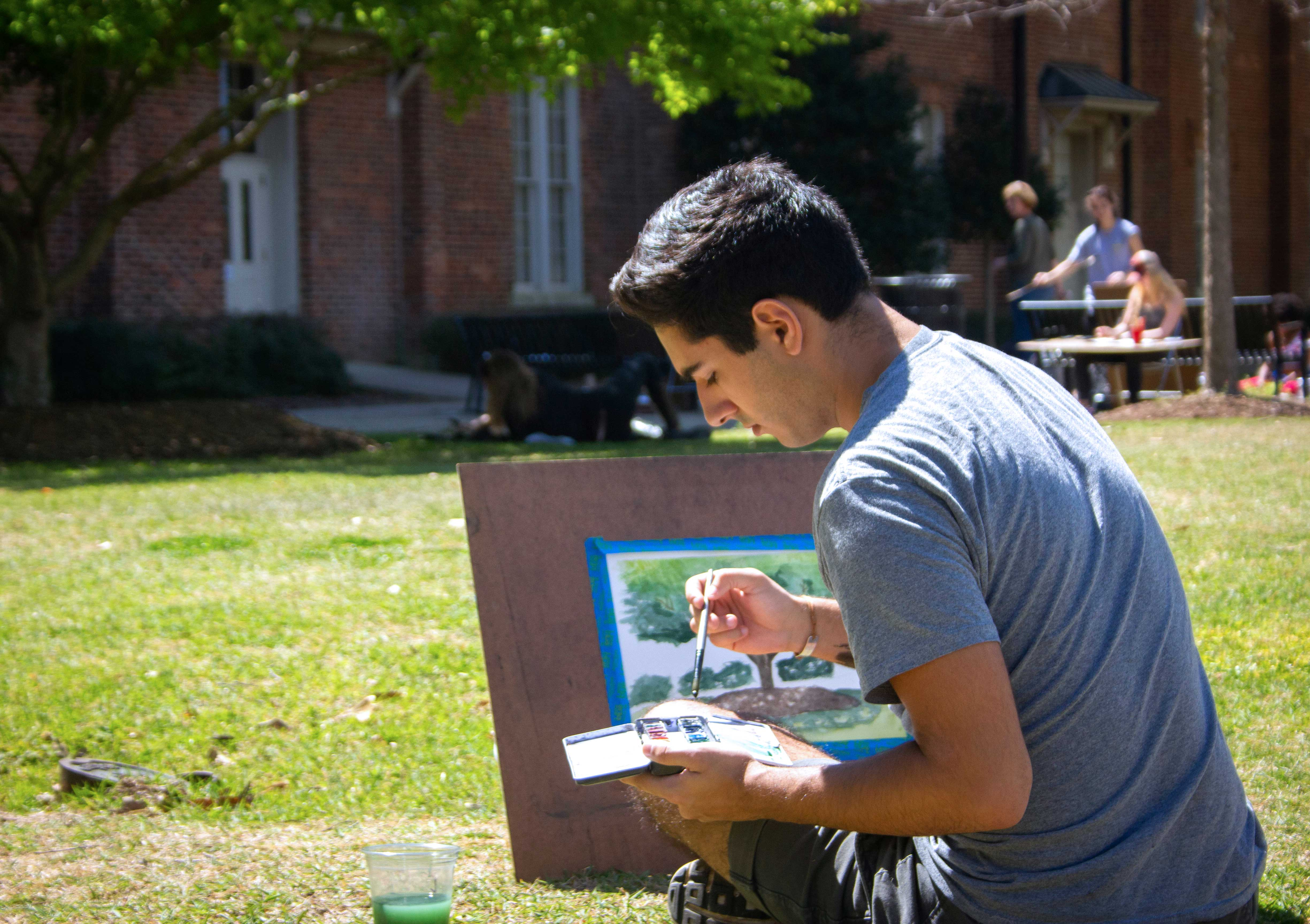 a student painting outdoors
