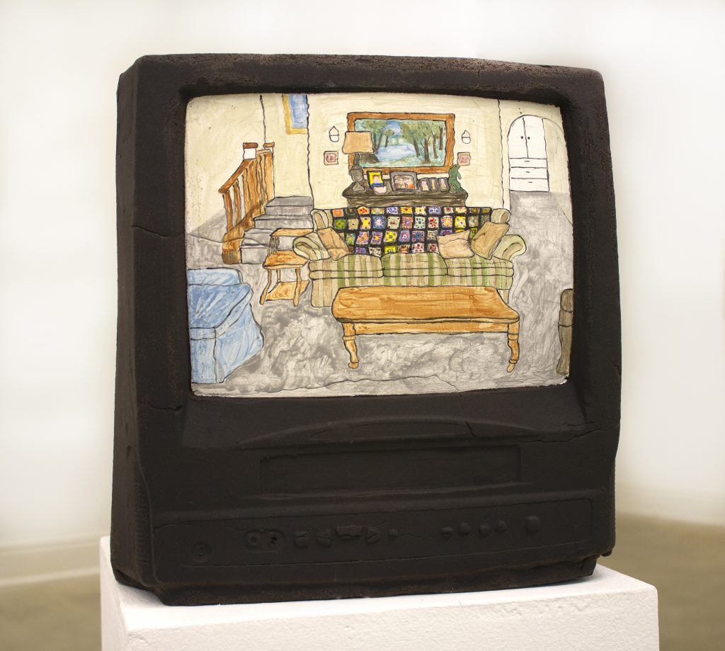 Sculpture of a television depicting a TV show scene of a lower middle class living room.