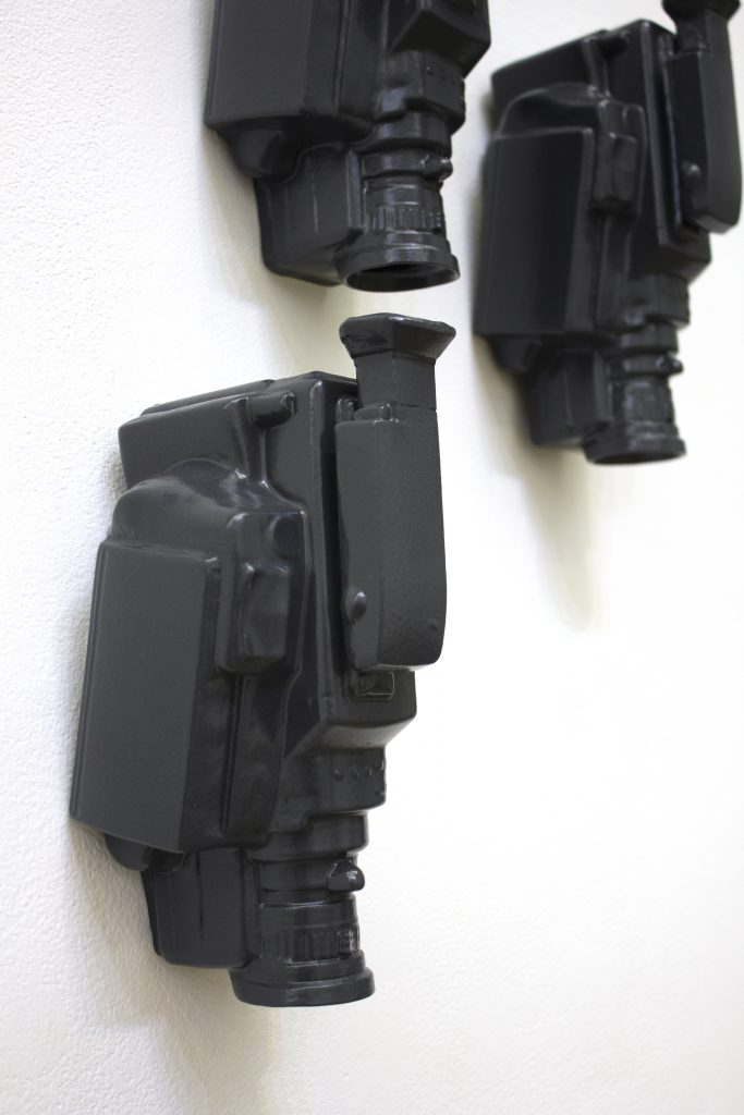 Sculpture of three video recorders made in ceramic