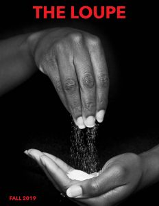 Magazine cover image with a hand sifting salt into another hand.
