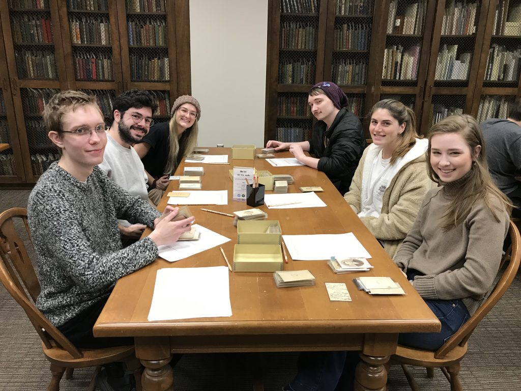 students sit around a table in a library