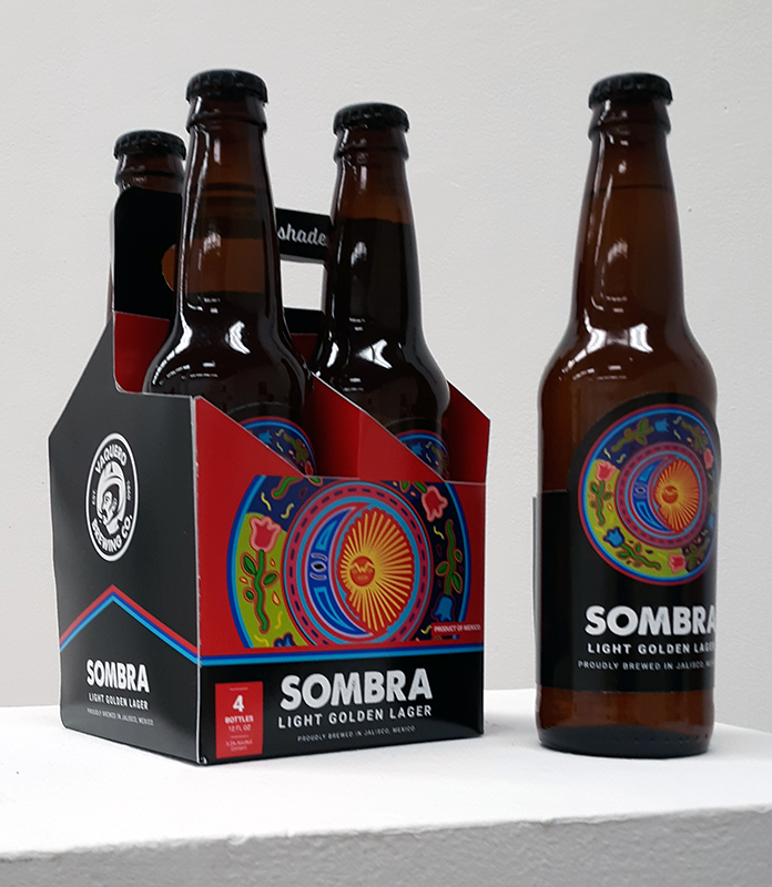 A four beer bottles in colorful packaging.