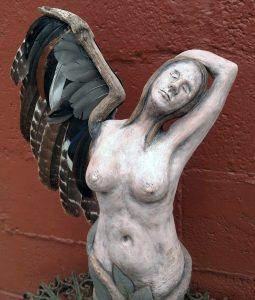 Sculpture of a woman with a bird wing.