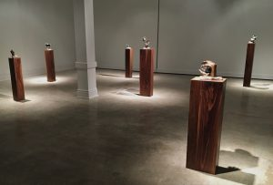 gallery with six pedestals with small bronze sculptures