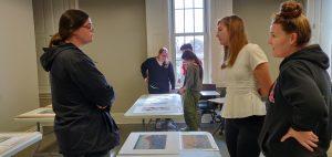 Students looking at woodblock prints