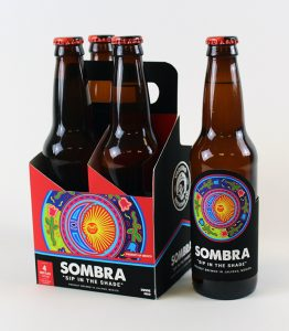 Four-pack of beer with brightly colored label and package design.