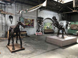skylit studio with metal sculptures.