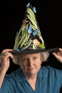 woman wearing a decorated cone hat.