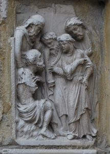 a stone sculptural group in high relief