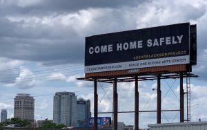 a billboard looms high over the freeway in Birmingham